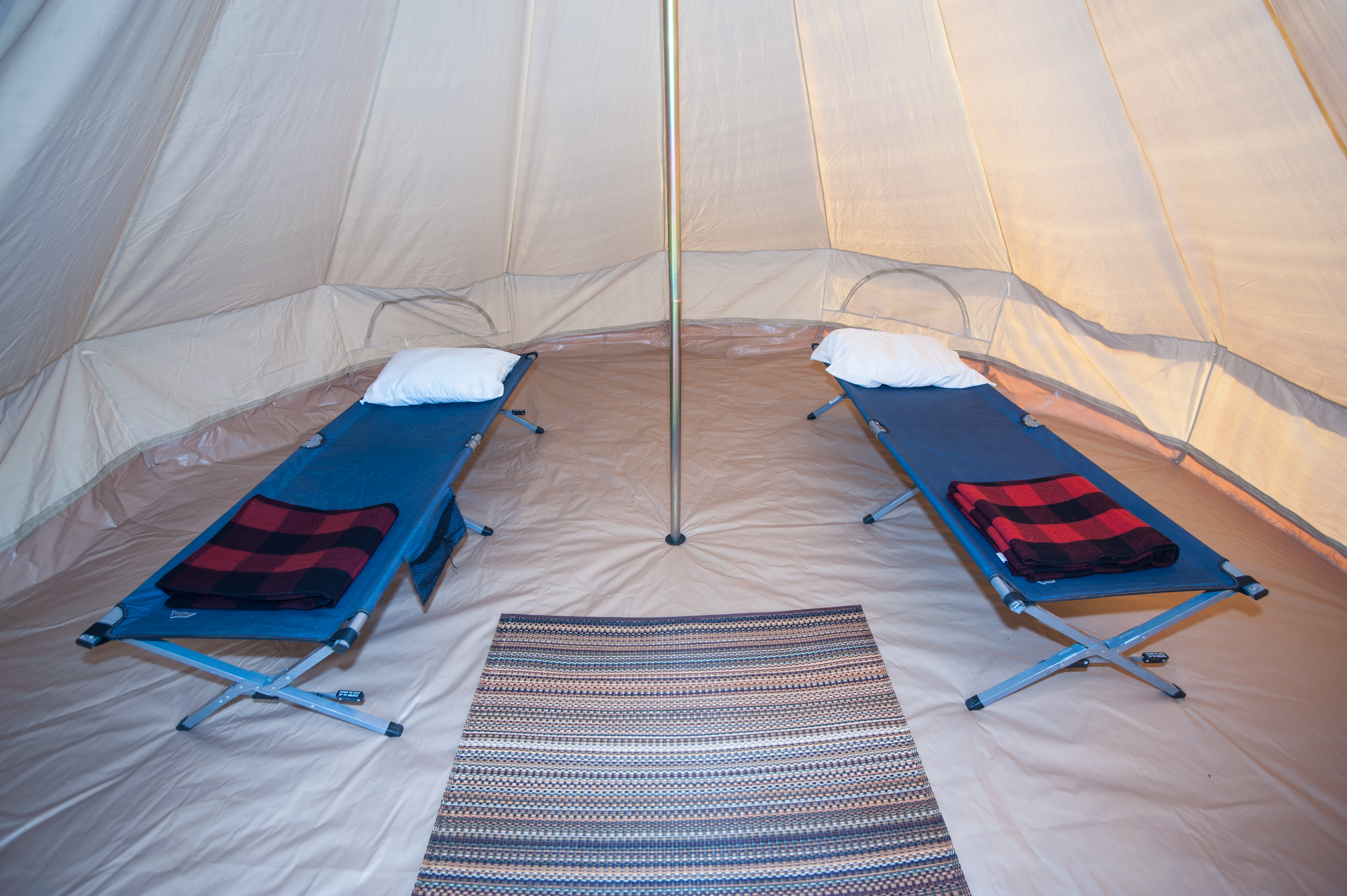 tent with glamping rug cot